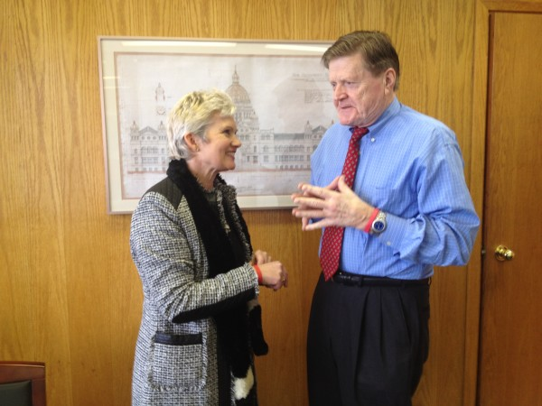 Barb of Bears Matter speaking to West Vancouver MLA Ralph Sultan about the Trophy Killing of Grizzlies. Mr. Sultan wearing a 'stop the hunt' wristband given to him by Barb